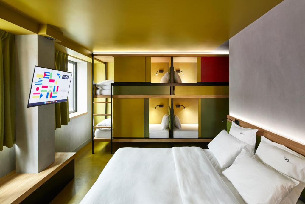 A bed or beds in a room at YOOMA Urban Lodge