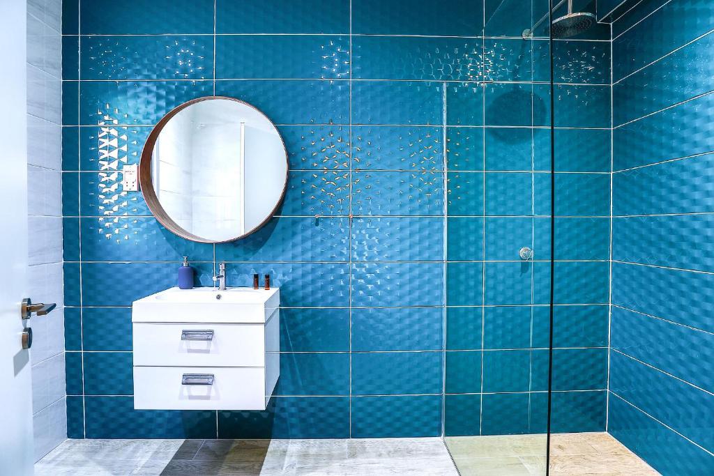 A bathroom at Vega Apartments
