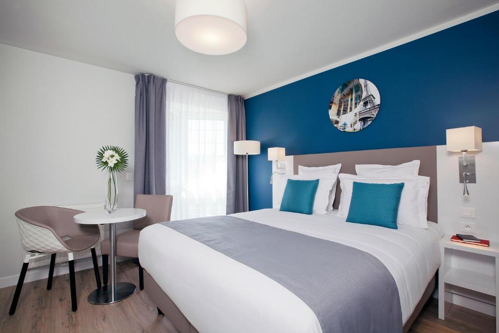Postel nebo postele na pokoji v ubytování Residhome Paris Gare de Lyon - Jacqueline de Romilly