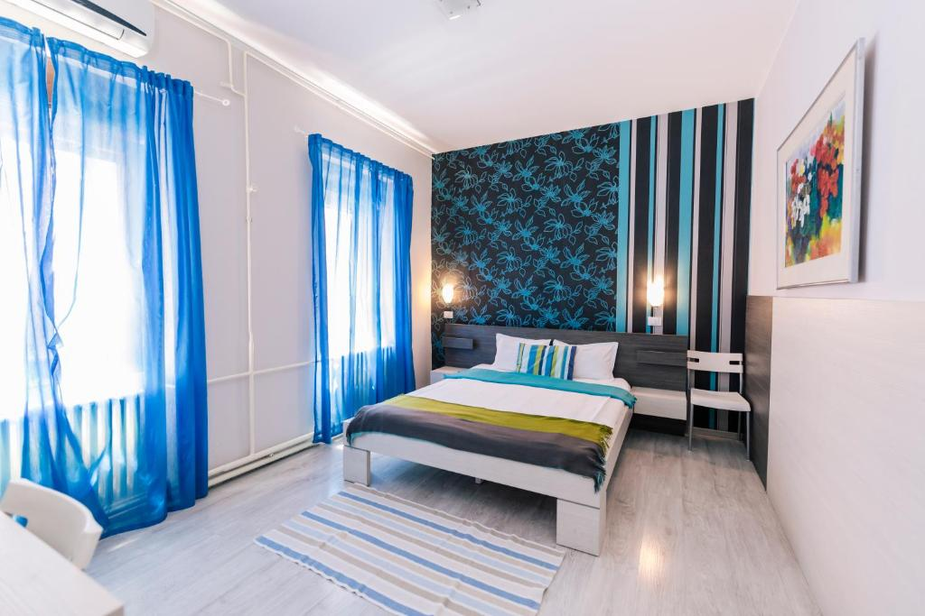 A bed or beds in a room at Garni Citi Hotel Veliki