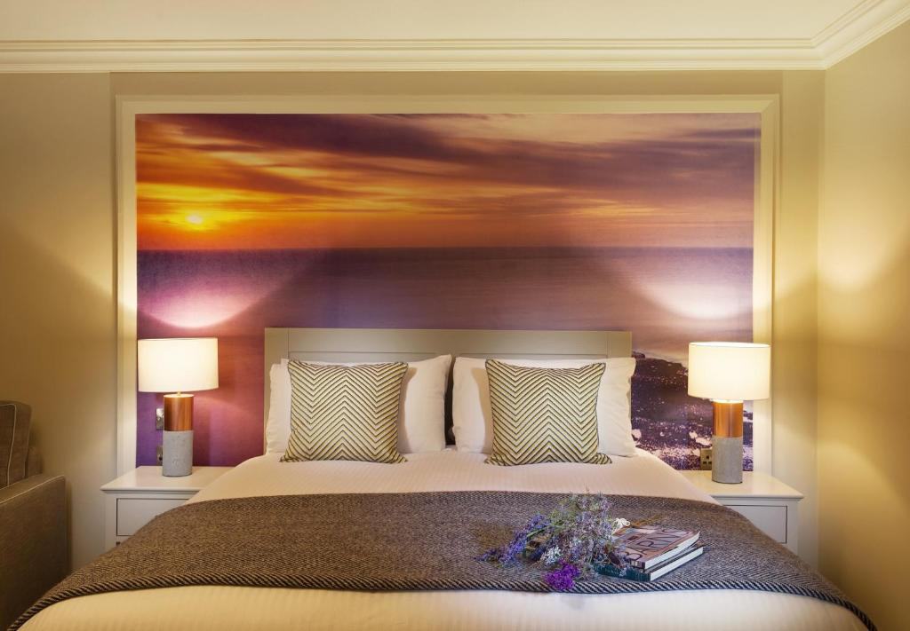 A bed or beds in a room at The Wild Atlantic Lodge