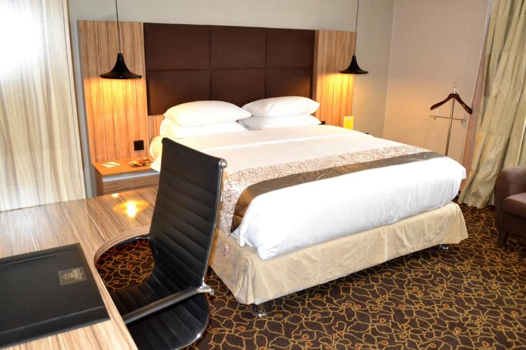 A bed or beds in a room at Best Premier Hotel Wuse 2