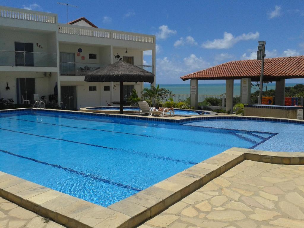 The swimming pool at or near Residencial Granito e Jasmim