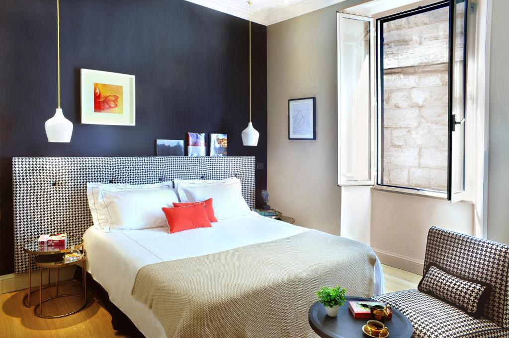 A bed or beds in a room at Nerva Boutique Hotel