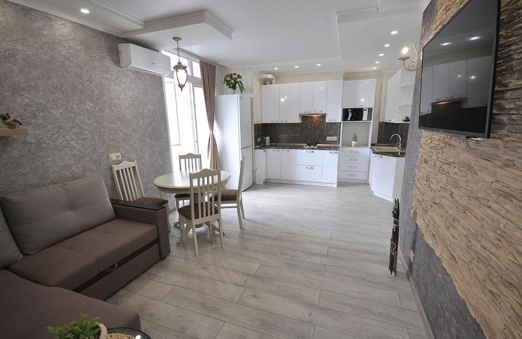 Кухня или мини-кухня в Business Apartment Griboyedova 31