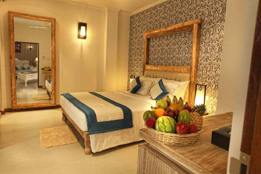 A bed or beds in a room at Rivora Residence