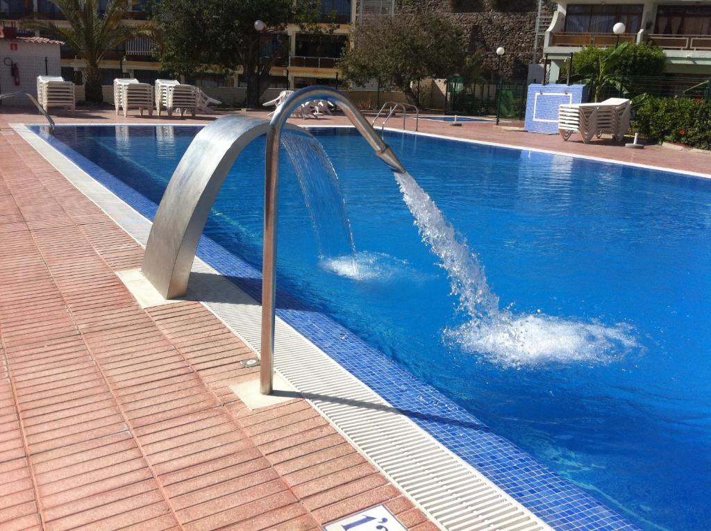 Het zwembad bij of vlak bij Apartamentos Australia