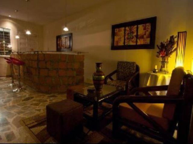 Zona de estar de 61Prado Hotel