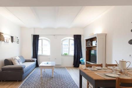 A seating area at Stadt-Apartment