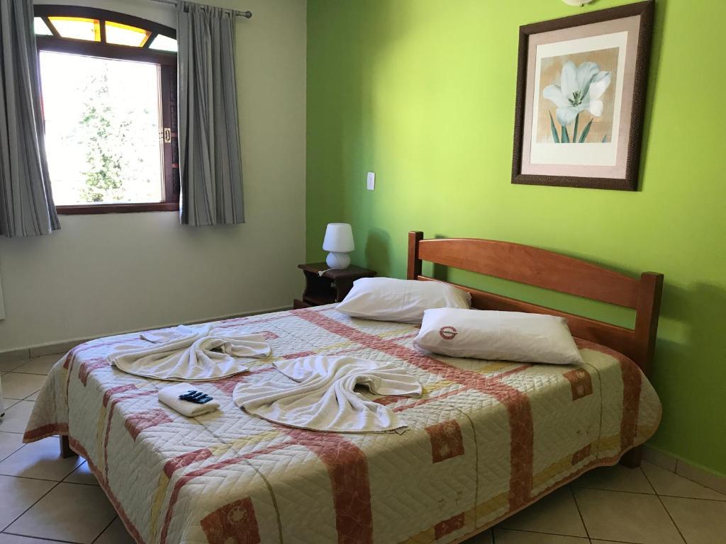 Cama ou camas em um quarto em Pousada Alentejano I