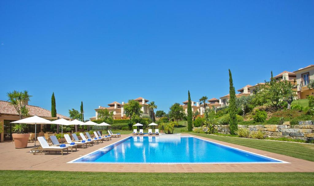 The swimming pool at or near Monte Rei Golf & Country Club