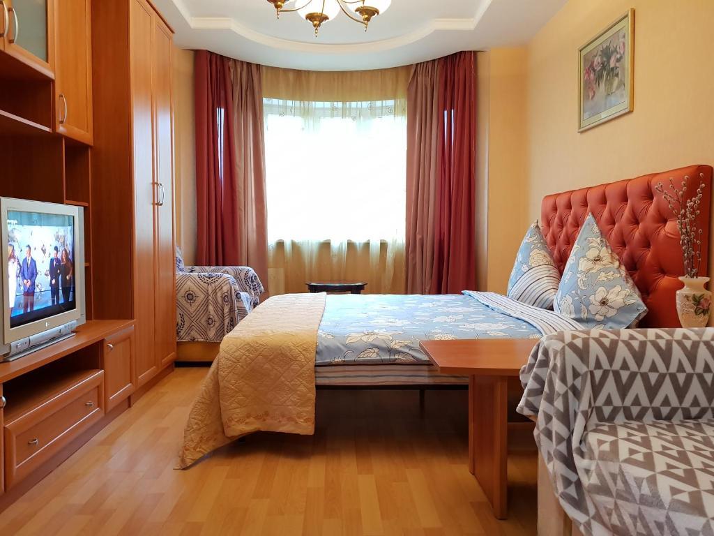 Кровать или кровати в номере Апартамент ДеЛюкс на Дмитрия Ульянова