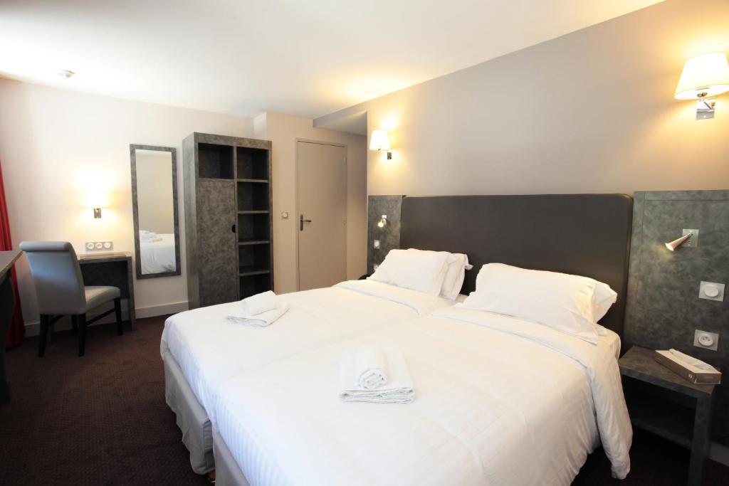 Un ou plusieurs lits dans un hébergement de l'établissement La Table de Gustave