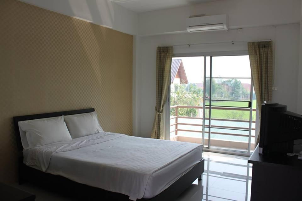 A bed or beds in a room at Fang Villa Hotel