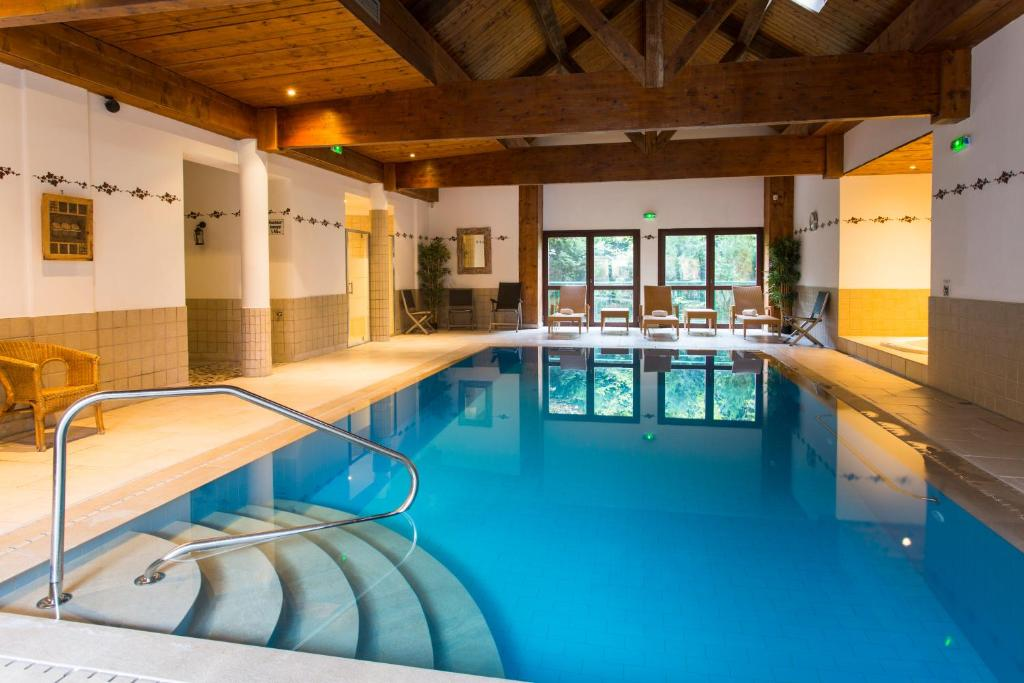 The swimming pool at or near Le Domaine de Rouffach