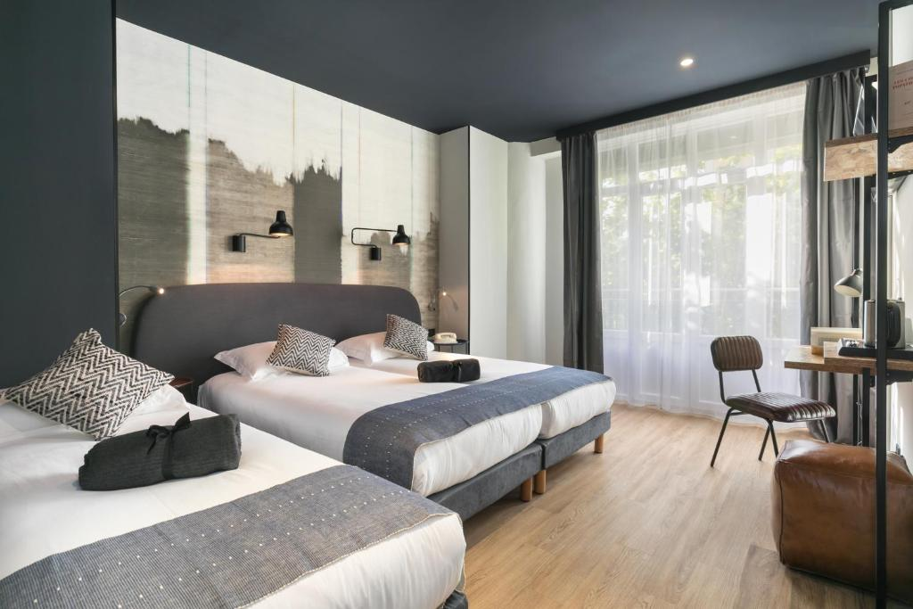 A bed or beds in a room at Hotel So'Co by Happyculture