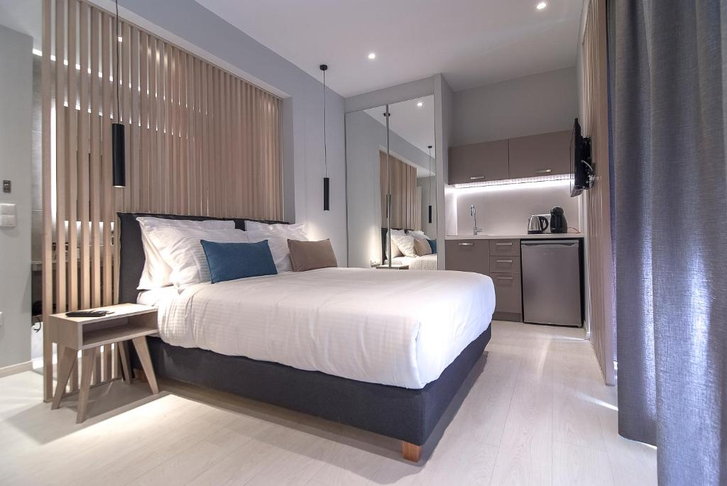 A bed or beds in a room at Acropolis Stay