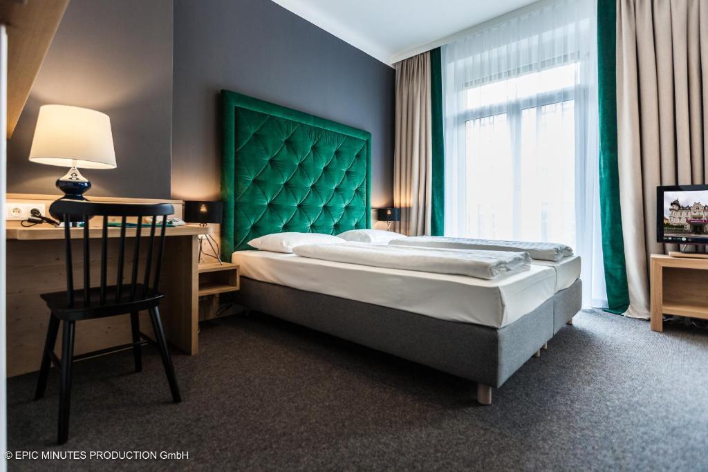Letto o letti in una camera di Hotel Markus Sittikus