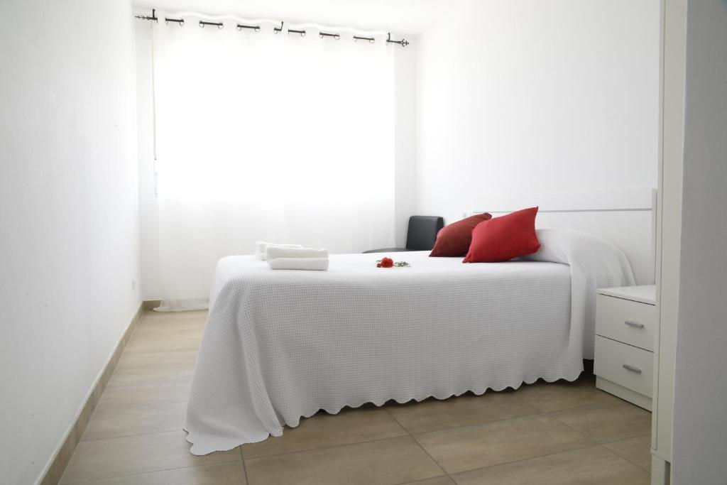 A bed or beds in a room at Mar de Fora