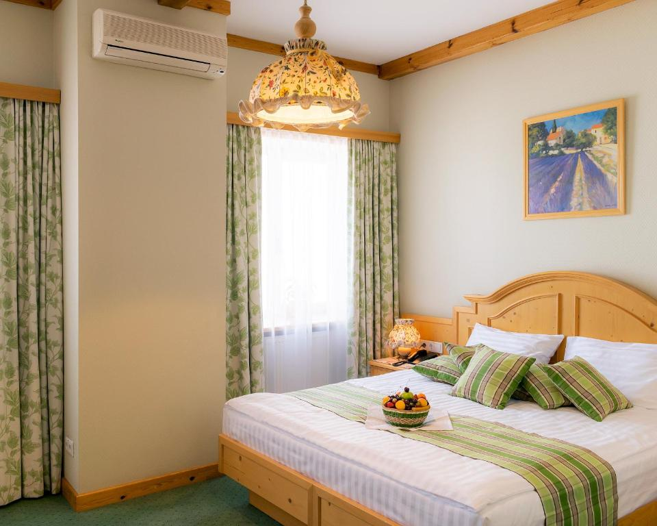 A bed or beds in a room at Landhaus Hotel