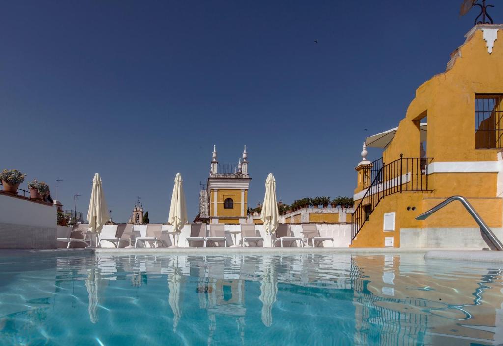 The swimming pool at or near Hotel Las Casas de la Judería