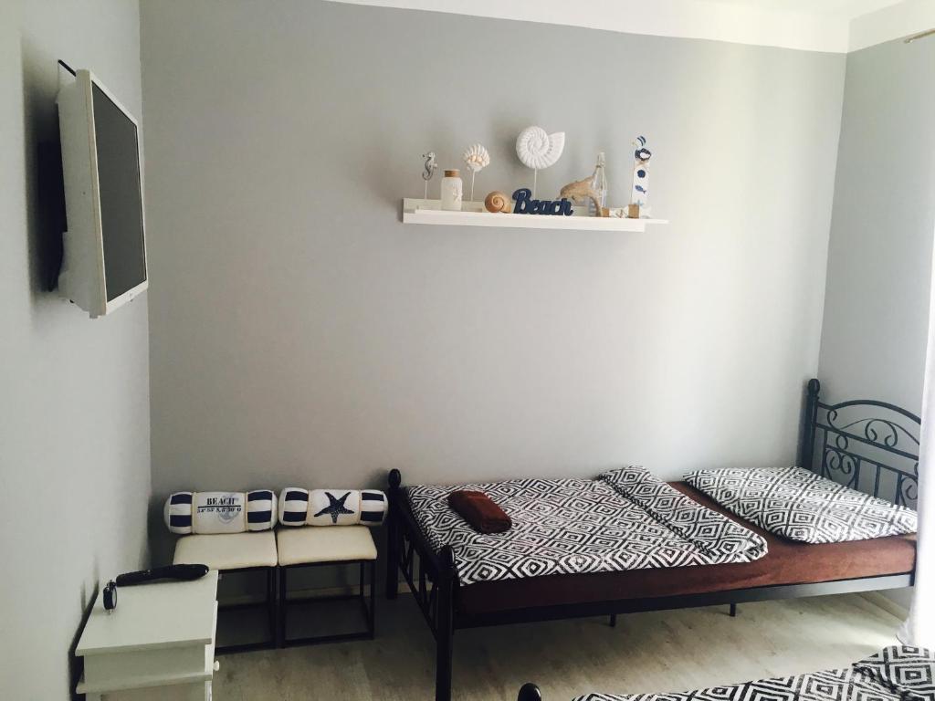Posteľ alebo postele v izbe v ubytovaní Mini Motel