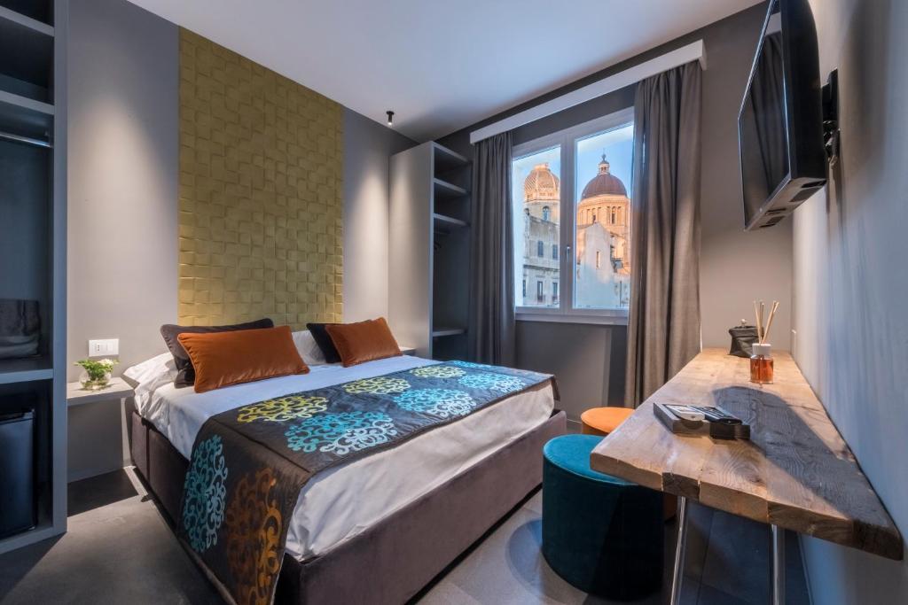 Letto o letti in una camera di Slo Design House
