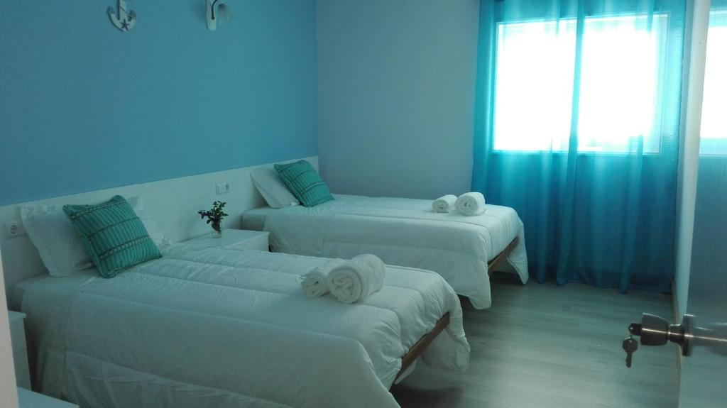 A bed or beds in a room at Cabedelo Seaside GuestHouse