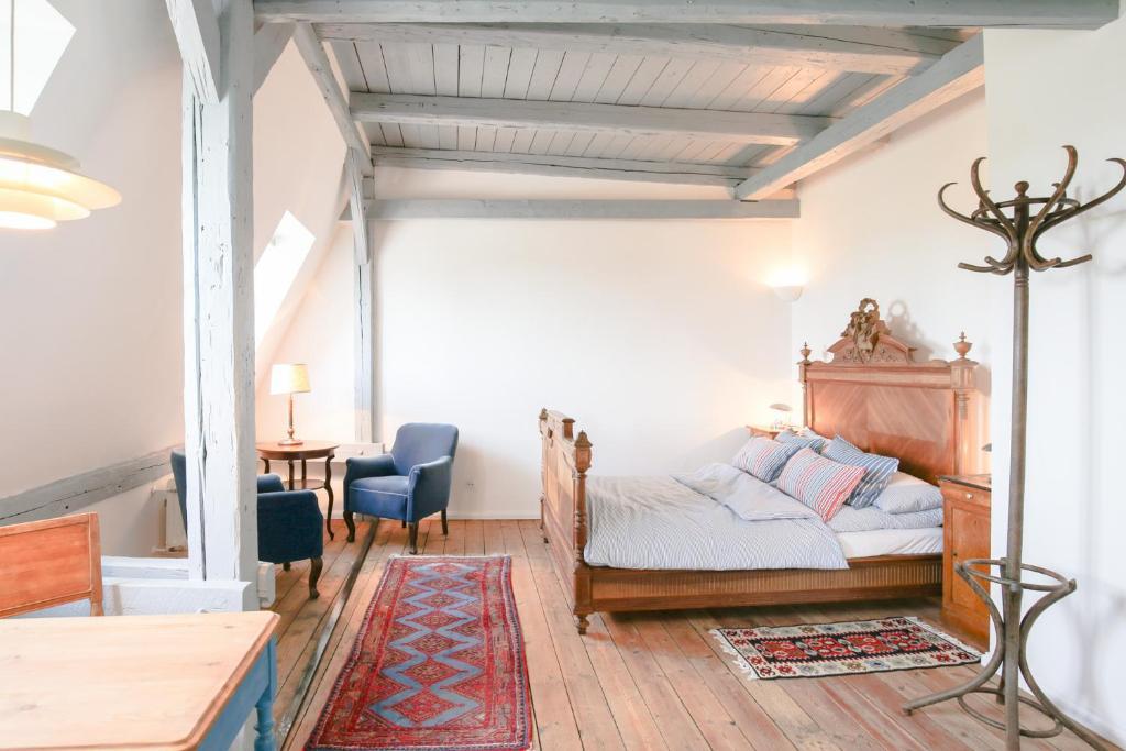 Ein Bett oder Betten in einem Zimmer der Unterkunft Gasthaus Lammkontor