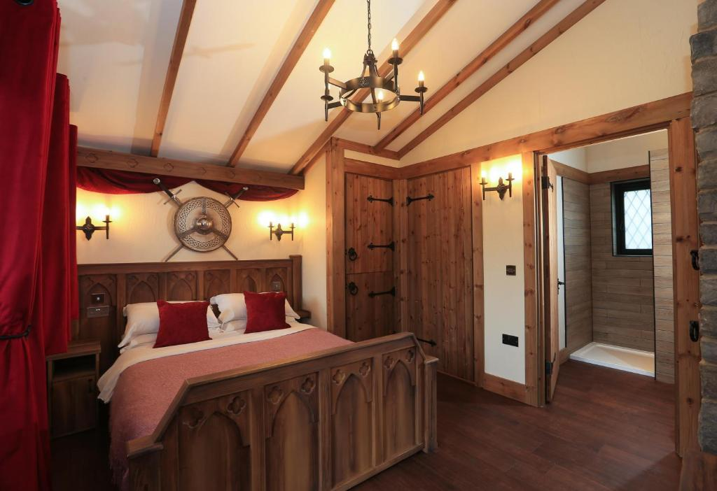 A bed or beds in a room at Warwick Castle Knight's Village
