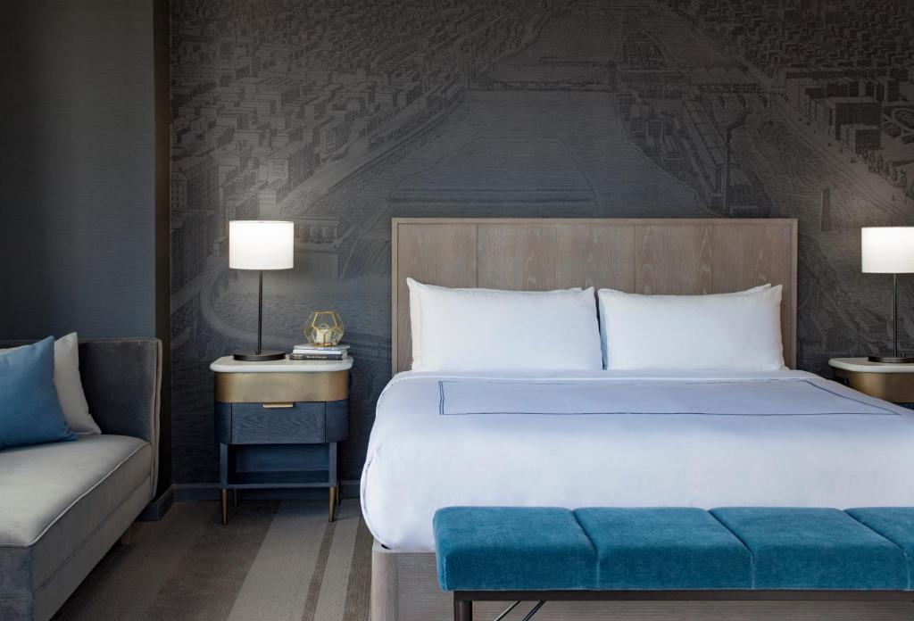 A bed or beds in a room at The Marquette Hotel, Curio Collection by Hilton