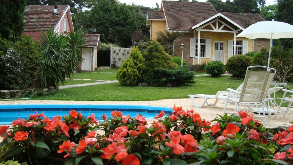 The swimming pool at or near Pousada Aldeia dos Sonhos
