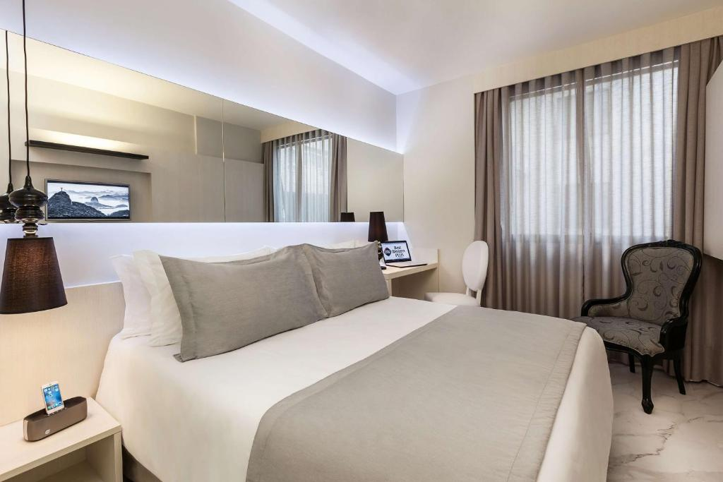 A bed or beds in a room at Nobile Hotel Copacabana Design