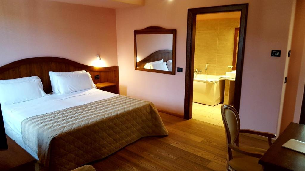 Letto o letti in una camera di Hotel Cascina Canova
