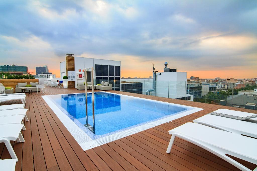 The swimming pool at or near ZT The Golden Hotel Barcelona