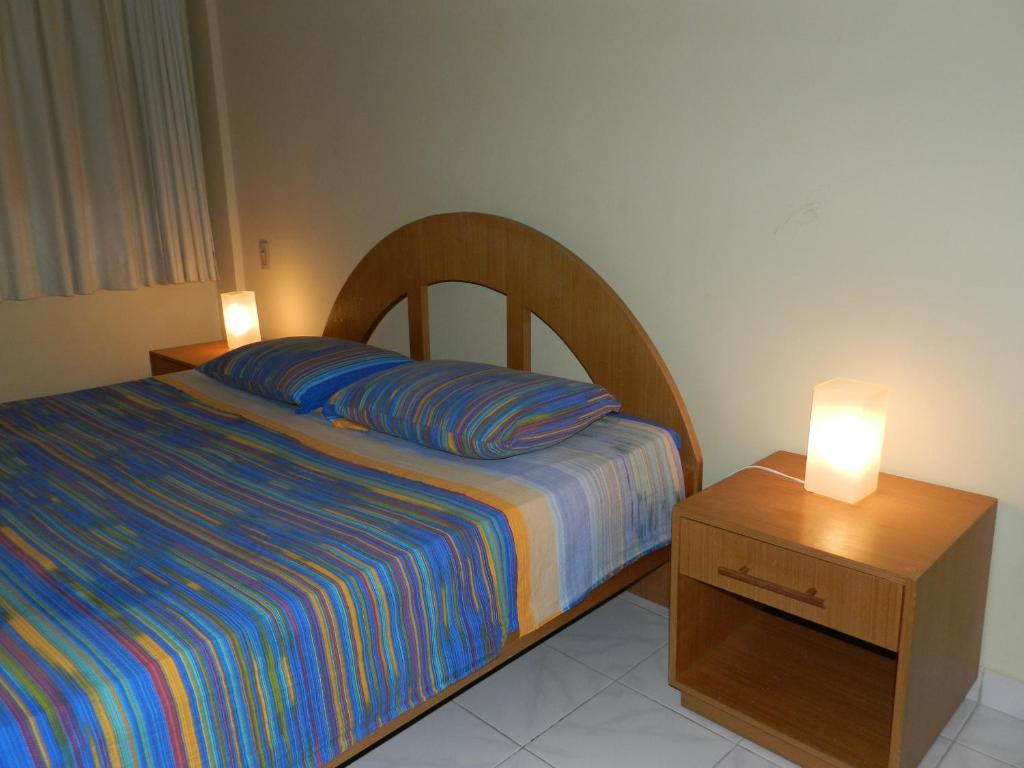 A bed or beds in a room at Aparthotel Eporedia
