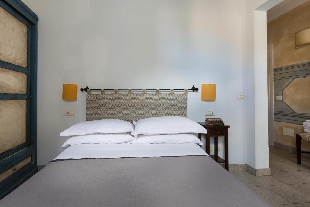 Letto o letti in una camera di Residenza Baldesca