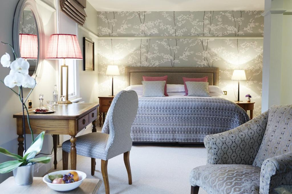 A bed or beds in a room at Castle House Hotel