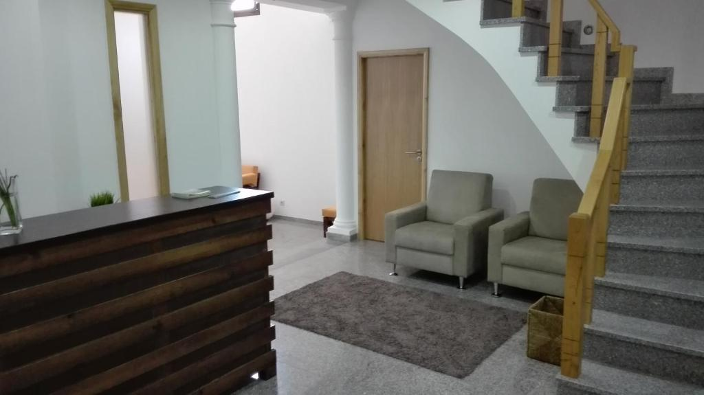 A seating area at VistaFreita- Rooms & Suites