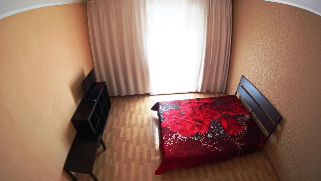 Кровать или кровати в номере Апартаменты у Вокзала