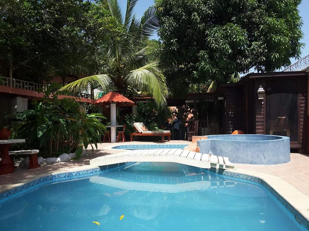The swimming pool at or near Posada Las Iguanas