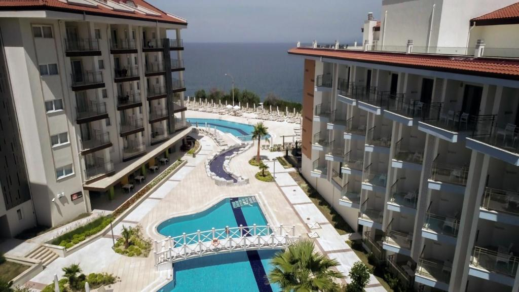 A view of the pool at Ramada Hotel & Suites Kusadasi or nearby