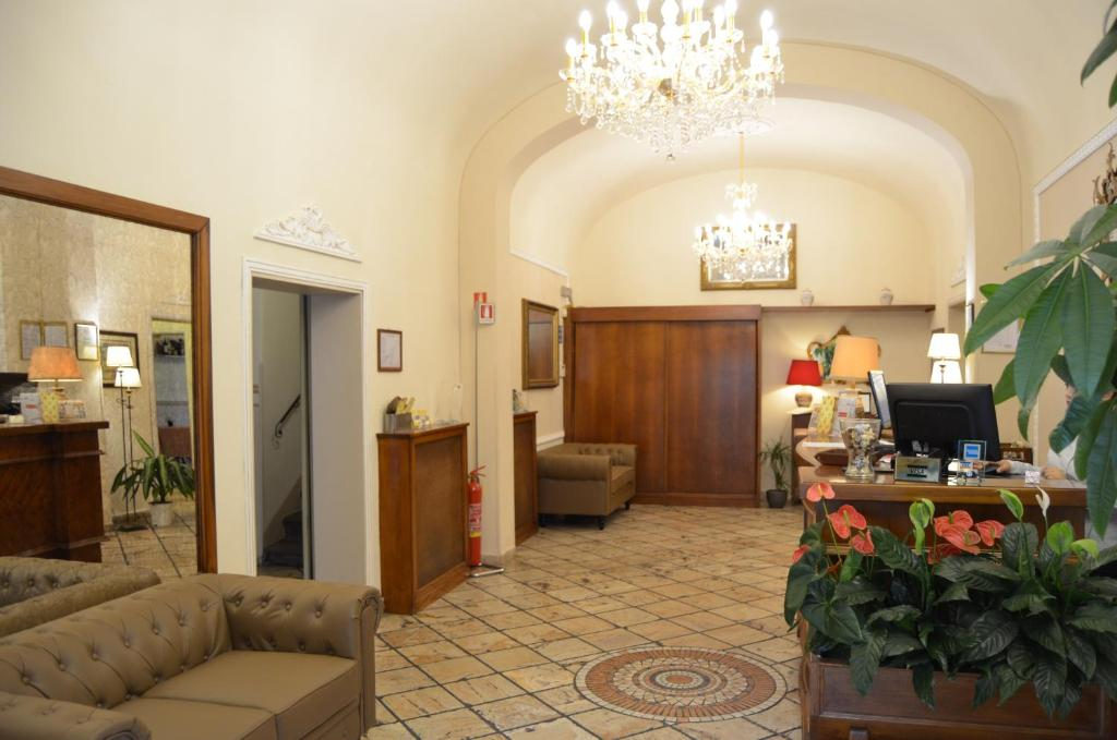 The lobby or reception area at Hotel Minerva