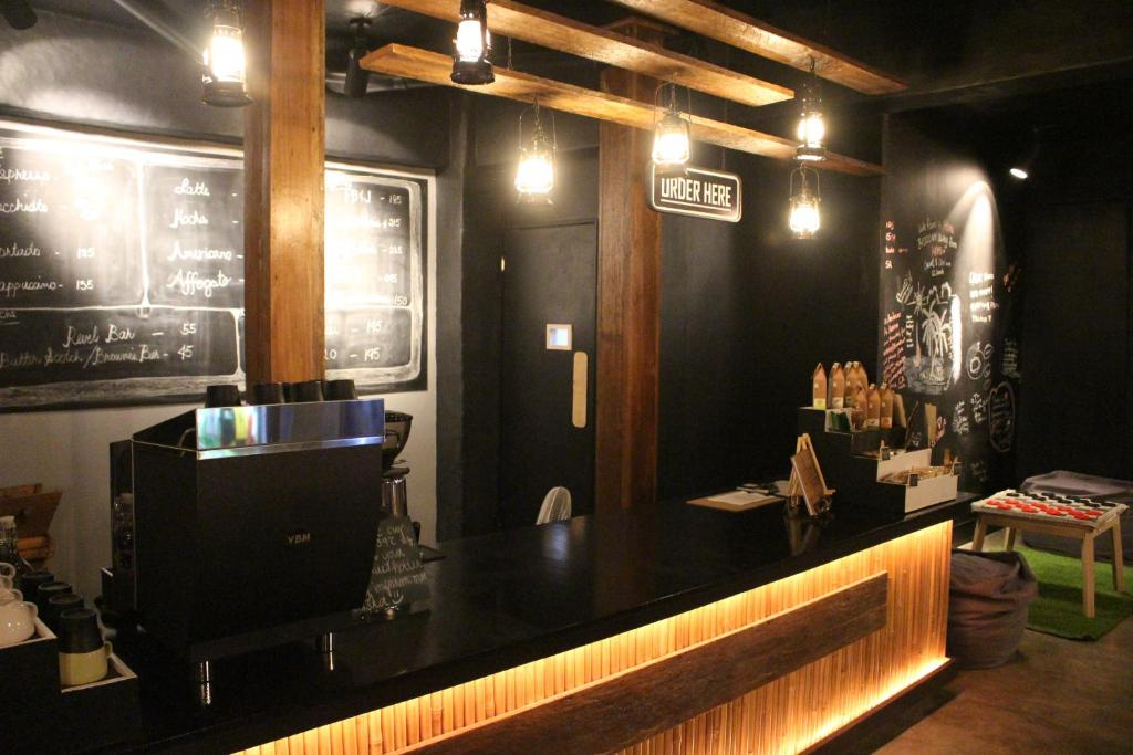 The lobby or reception area at The Cavern Pod Hotel & Specialty Cafe