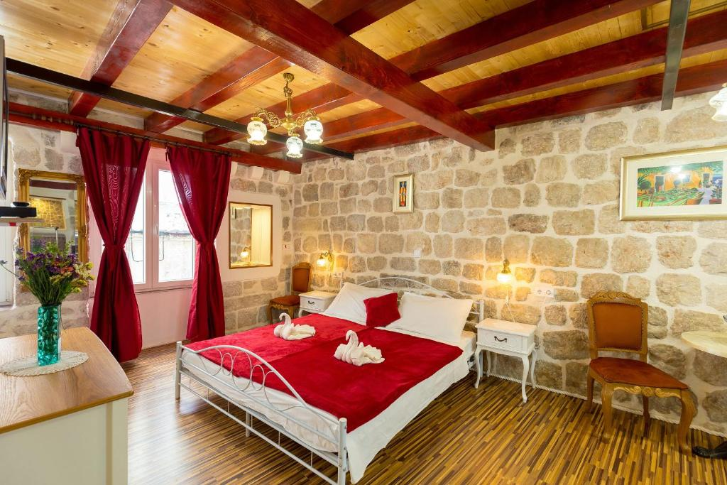 Letto o letti in una camera di Juliette's Palace Studios