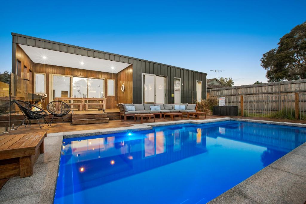 The swimming pool at or near Moonah Beachside Retreat