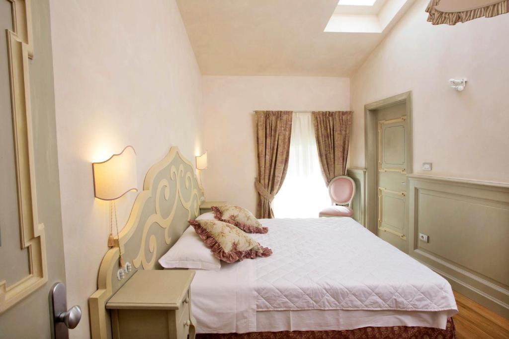 Letto o letti in una camera di Casa del Vino della Vallagarina