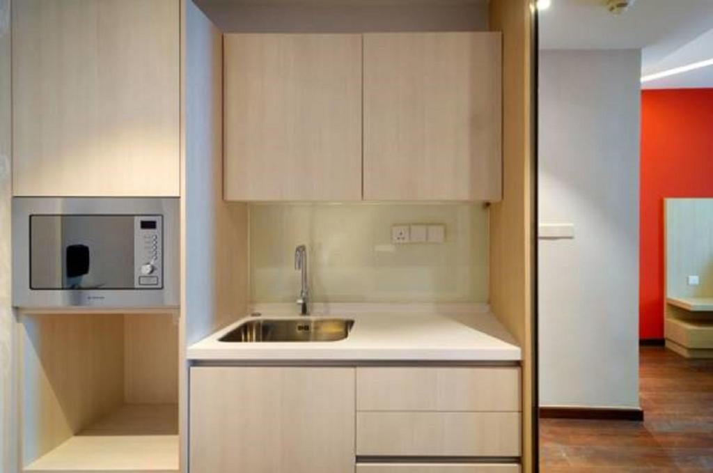 A kitchen or kitchenette at The Klagan @ Riverson Hotel