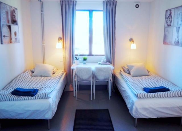Säng eller sängar i ett rum på Turistgårdens vandrarhem i Norrköping