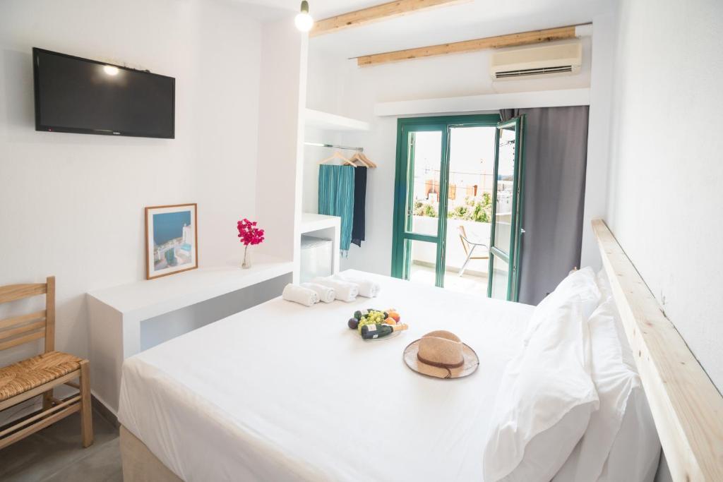 Ένα ή περισσότερα κρεβάτια σε δωμάτιο στο Ifestia Hotel